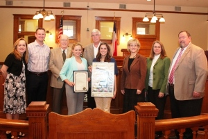 After reading the proclamation for Williamson County Ag Day, Judge Gattis and the commissioners were presented a print of the 2015 National Ag Day original artwork. Those attending included: Precinct 1 Commisioner Lisa Birkman, Round Rock LoneStar Ag Credit Vice President Nathan Winstead, Precinct 4 Commissioner Ron Morrison, Williamson County AgriLife Extension Agents Kaitlyne Davis and Chelsea Stevens, Judge Gattis, Precinct 3 Commissioner Valerie Covey, Precinct 2 Commissioners Cynthia Long, and Williamson County Agriculture Agent Fred M. Hall.